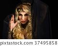 Woman fortune teller portrait at black 37495858