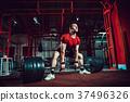 Muscular fitness man doing deadlift a barbell in 37496326