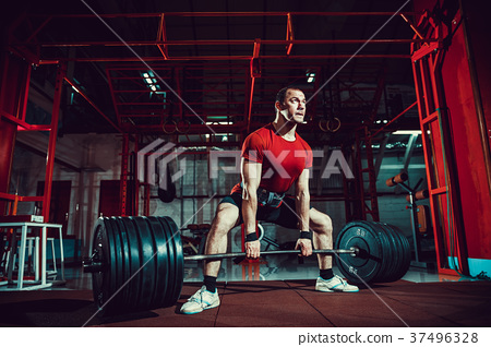Muscular fitness man doing deadlift a barbell in 37496328