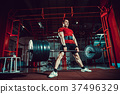 Muscular fitness man doing deadlift a barbell in 37496329