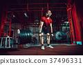 Muscular fitness man doing deadlift a barbell in 37496331