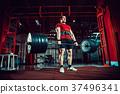 Muscular fitness man doing deadlift a barbell in 37496341