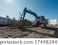 old and dirty excavator on construction site 37498264