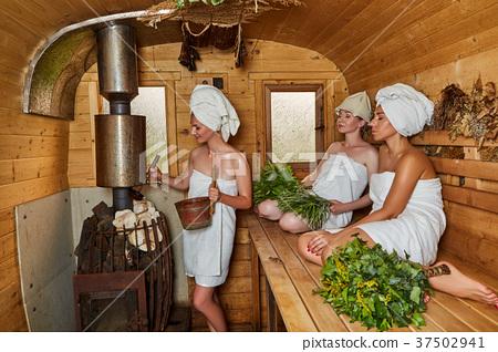 three girls relaxing in sauna 37502941