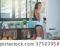 Young sexy woman in the kitchen lifestyle 37503958