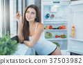 Young sexy woman in the kitchen lifestyle 37503982