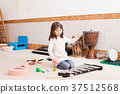 Cute girl playing on the xylophone 37512568