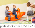Children on the rocking seesaw 37513573