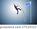 Businessman pole vaulting towards his goal in 37520322
