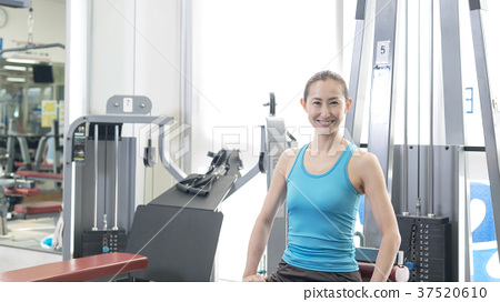 Women exercising at fitness gym 37520610