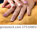 Asian young girl homemade fasion nail by oneself. 37520803