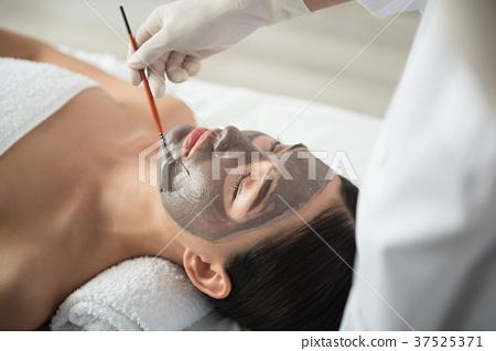 Professional beautician undergoing skin care 37525371