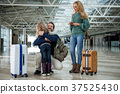 family, hug, airport 37525430