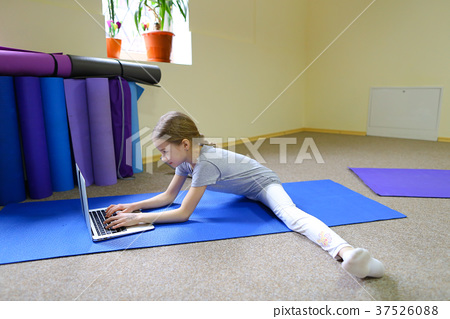 Girl sits on floor in twig position and rewritten 37526088