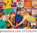 Children building blocks in kindergarten. Group 37526244