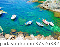 Beautiful cozy bay with boats and clear turquoise 37526382
