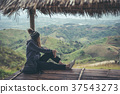 Young woman traveler sitting and looking view 37543273