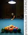 Playing billiard 37545902