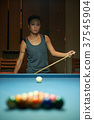 Pensive pool player 37545904