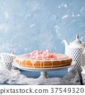 Bundt cake with frosting. Festive treat flowers 37549320