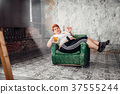 Overweight woman drinks beer, obesity 37555244