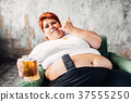 Overweight woman drinks beer, bulimic, obesity 37555250
