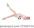 teenager lying on the floor with soccer ball  37560734