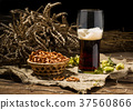 Glasse beer with wheat and hops, basket of 37560866