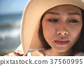Pretty woman in straw hat 37560995