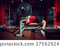 Man doing bench press workout in gym 37562624
