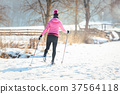 Woman doing cross country skiing as winter sport 37564118