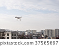 Drone flying above city and government buildings 37565697