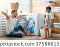 Happy family man father householder and child   in laundry with 37586613