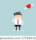 Businessman crying broken heart with heart flying 37588618
