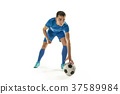 Professional football soccer player with ball 37589984