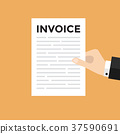 Hand holding a letter with Invoice headline 37590691
