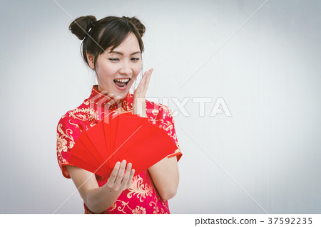 Asian woman holding red envelope,  37592235