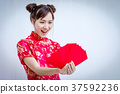 Asian woman holding red envelope,  37592236