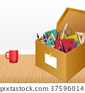 Office accessories in a cardboard box on wooden ba 37596014