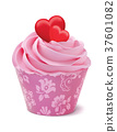 Cupcake or muffin decorated with hearts. 37601082