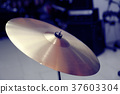 Cymbal closeup with drum set 37603304