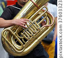 Musician is playing on the tuba. 37603323