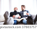 Hipster son and his senior father at home. 37603757