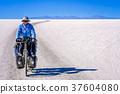 Cycling on the salar de Uyuni 37604080