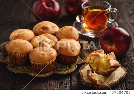 Homemade muffins with apple stuffing. 37604705