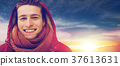 close up of happy man in winter jacket with hood 37613631
