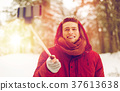 happy man taking selfie by smartphone in winter 37613638