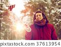 happy man taking selfie by smartphone in winter 37613954