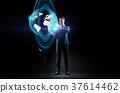 businessman with earth hologram over black 37614462