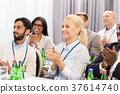 people applauding at business conference 37614740